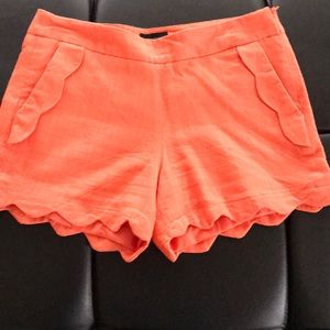 Orange scalloped pocket and edges shorts